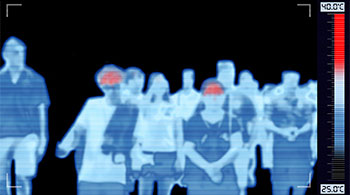 Thermal image of peole in a group and some with hot foreheads