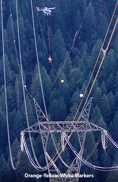 Orange, yellow and white power line markers